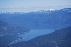 Lake Pend Oreille and snow covered Rocky Mountains towards Glacier Park