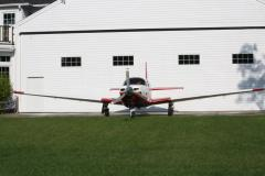 N3515H in front of Hangar at Falmouth Airpark