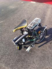Folded 16in Citizen bike, Toyko model. Just fits in baggage door on Mooney.