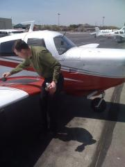 Me preflighting the plane.  Is there any gas in there?