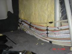 Wiring under side walls in cabin